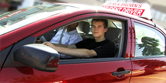 Student driver in one of driving school cars.